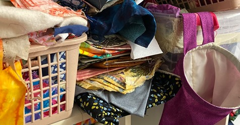 Picture of mixed fabrics  advertising new Mystery Quilt