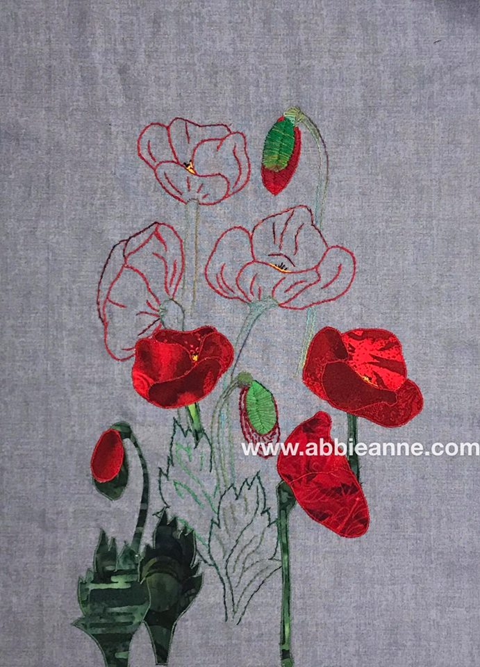 Textile art piece depicting poppies